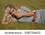 a woman is laying on the grass... | Shutterstock . vector #108724652