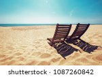 two beach chairs on empty ocean ... | Shutterstock . vector #1087260842