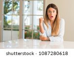 young beautiful woman at home... | Shutterstock . vector #1087280618