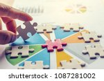 the man playing the jigsaw... | Shutterstock . vector #1087281002
