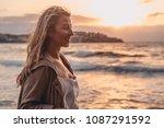 blonde woman on sunset lit... | Shutterstock . vector #1087291592