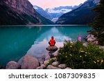 woman meditating on beach at... | Shutterstock . vector #1087309835