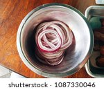 purple onion cut into slices on ...