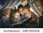 family bedtime. mom and... | Shutterstock . vector #1087354328