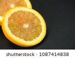 orange  two slices of orange on ... | Shutterstock . vector #1087414838