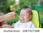 crying infant baby boy with... | Shutterstock . vector #1087427288