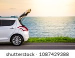 hatchback car on the beach road ... | Shutterstock . vector #1087429388