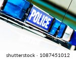 police vehicle sign with blue... | Shutterstock . vector #1087451012