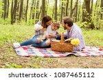 happy parents enjoying picnic... | Shutterstock . vector #1087465112