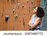 bouldering  beautiful girl look ... | Shutterstock . vector #1087480772