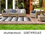 rattan sofa and armchair with... | Shutterstock . vector #1087490165