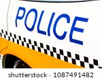 police sign on the side of a... | Shutterstock . vector #1087491482