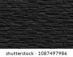 black brick wall of dark stone... | Shutterstock . vector #1087497986