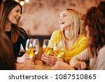 female friends drinking wine... | Shutterstock . vector #1087510865