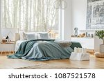 green and blue bedsheets on bed ... | Shutterstock . vector #1087521578