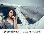 girl posing near aircraft ... | Shutterstock . vector #1087549196