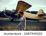 young pretty woman posing near... | Shutterstock . vector #1087549202