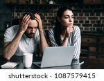 sad young couple sitting on... | Shutterstock . vector #1087579415