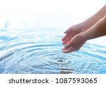 water dropping from a hand | Shutterstock . vector #1087593065