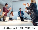 group of coworkers clapping in... | Shutterstock . vector #1087601135