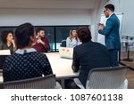 group of coworkers during a... | Shutterstock . vector #1087601138