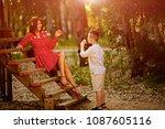 happy child blowing dandelion... | Shutterstock . vector #1087605116