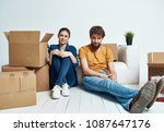 young people unpack boxes       ... | Shutterstock . vector #1087647176
