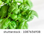 fresh organic basil on marble... | Shutterstock . vector #1087656938