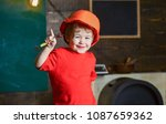 smiling kid holding spanner and ... | Shutterstock . vector #1087659362