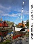 Fishing boat in village on Lofoten islands in Norway - stock photo