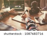 youtuber editing video on... | Shutterstock . vector #1087683716