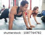 man and woman doing push ups... | Shutterstock . vector #1087764782