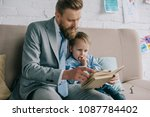 businessman and little son... | Shutterstock . vector #1087784402