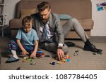 businessman in suit and little... | Shutterstock . vector #1087784405