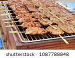 pork roast on street food | Shutterstock . vector #1087788848
