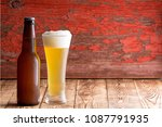 ice cold frothy pale ale in a... | Shutterstock . vector #1087791935