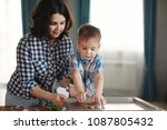 mother and son dressed in plaid ... | Shutterstock . vector #1087805432