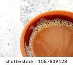 tea in a soil made cup | Shutterstock . vector #1087839128