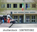 "Small photo of Benevento, Campania, Italy - April 5, 2017: An ambulance Pronto Soccorso of Mercy while at the scientific high school institution ""Rummo"""