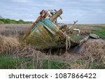 An Abandoned Boat Decaying On...