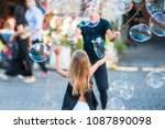 adorable little girl blowing... | Shutterstock . vector #1087890098
