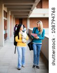 Stock photo young college students walking on campus 108794768