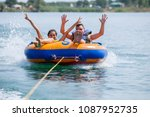 young couiple on water... | Shutterstock . vector #1087952735