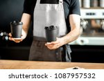 barista holding paper cups to... | Shutterstock . vector #1087957532