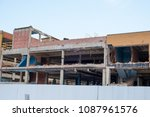 building demo being done to... | Shutterstock . vector #1087961576