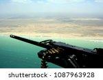 blurry machine gun with the... | Shutterstock . vector #1087963928