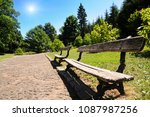 wooden benches in the park with ... | Shutterstock . vector #1087987256