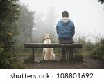 Stock photo lost man with his dog in mountain 108801692