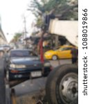 Small photo of Blurred a tow truck are towing black vehicle are broken on the road to prevent the danger of accidental duplications and delivers to the garage