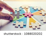 Small photo of The man playing the jigsaw puzzle with graph summary. Business concept. Red and white puzzles.